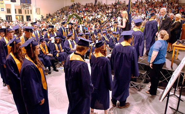 The class of 2013 of Shenandoah High School line up to cross the stage to receive their diplomas during commencement Sunday.
