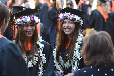 José Quezada/For The Times-Standard  Arcata High School graduates and twin sisters Holianna Deaver Leilani Deaver minutes before the Arcata Class of 2013 was graduated.  Arcata High School and Pacific Coast High School celebrated a new cadre of graduates in a late Thursday afternoon ceremony at Redwood Bowl at Humboldt State University.