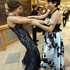 Groton-Dunstable pre-prom gathering at the high school. Carolyn Abraham of Groton, left, greets Willow Chau, allso of Groton. (SUN/Julia Malakie)