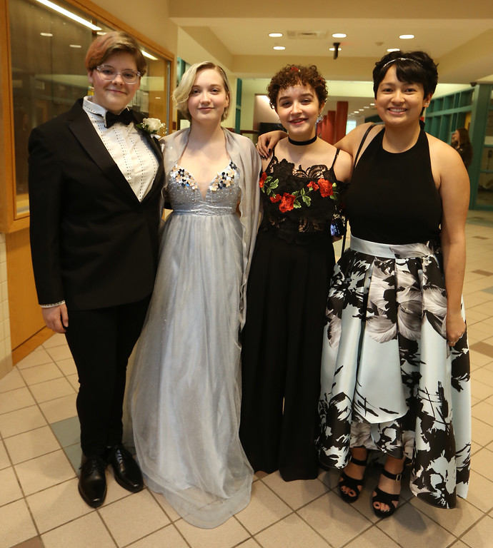 . Groton-Dunstable pre-prom gathering at the high school. From left, Britney Lord of Dunstable, Aurora Edwards of Groton, Madison Collins of Groton, and Willow Chau of Groton. (SUN/Julia Malakie)
