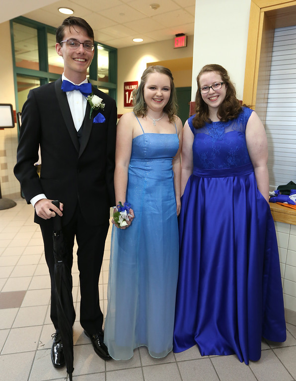 . Groton-Dunstable pre-prom gathering at the high school. From left,Thomas Cote of Groton, Hannah Crooks of Hampton, N.H., and Leah Pettee of Dunstable. (SUN/Julia Malakie)