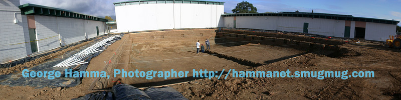 (5/2003) The shape of the new, single pool was laid out in the same space.