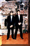 """Jesuit High School Junior-Senior Prom - May, 1989 <br /> My parents' house, New Orleans, LA<br /> <br /> Just proving again how big of nerds we were. We're doing the """"stoic"""" pose and wearing Wayfarers and black shark skin cowboy boots."""