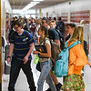 Students walk through the halls after second period at Pioneer Junior/Senior High School during the first day of the 2021-22 school year in Royal Center on Wednesday, Aug. 11, 2021.
