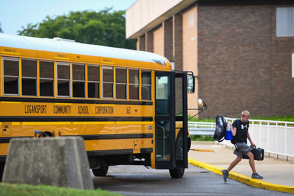 A student is dropped off by the bus at Logansport High School for the first day of 2021-22 school year on Wednesday, Aug. 11, 2021.