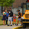 Students are dropped off by the bus at Logansport High School for the first day of the 2021-22 school year on Wednesday, Aug. 11, 2021.