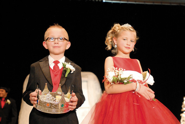 Crown bearer Isaac Brown and flower girl Sophia Hensley perform their duties.