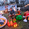 KRISTOPHER RADDER — BRATTLEBORO REFORMER<br /> Travis Sweetser, 15, of Hinsdale, puts up a dazzling holiday display. The house on 25 Old Chesterfield Road is brightly lit with reindeers on the roof and different inflatables putting on a show in the yard.
