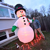 KRISTOPHER RADDER — BRATTLEBORO REFORMER<br /> Travis Sweetser, 15, of Hinsdale,  stands next to his 10-foot-tall inflatable snowman.