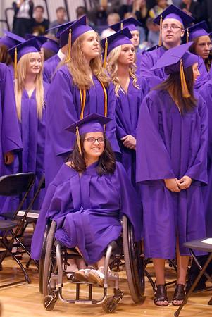 Yaremi Jones watches fellow graduates during Wednesday's Holy Family High School graduation ceremony.<br /> May 18, 2011<br /> staff photo/David R. Jennings