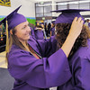 Lexi Laschinger, left, adjusts the cap of Mary Jones before the Holy Family High School graduation ceremony on Wednesday.<br /> May 18, 2011<br /> staff photo/David R. Jennings