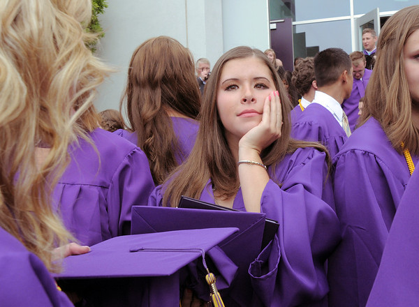 Mary Caldwell looks for friends after Wednesday's Holy Family High School graduation ceremony.<br /> May 18, 2011<br /> staff photo/David R. Jennings