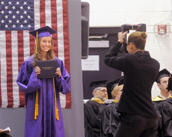 Sarah Talamantes is photographed with her diploma during Wednesday's Holy Family High School graduation ceremony.<br /> May 18, 2011<br /> staff photo/David R. Jennings