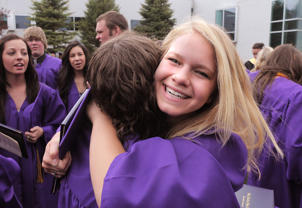 Rachel Anderson hugs Kayla Brienza after Wednesday's Holy Family High School graduation ceremony.<br /> May 18, 2011<br /> staff photo/David R. Jennings