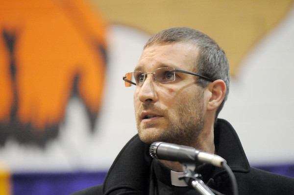 Reverend Gabriele Azzalin, Chaplin of Holy Family High School, gives the invocation during Wednesday's Holy Family High School graduation ceremony.<br /> May 18, 2011<br /> staff photo/David R. Jennings
