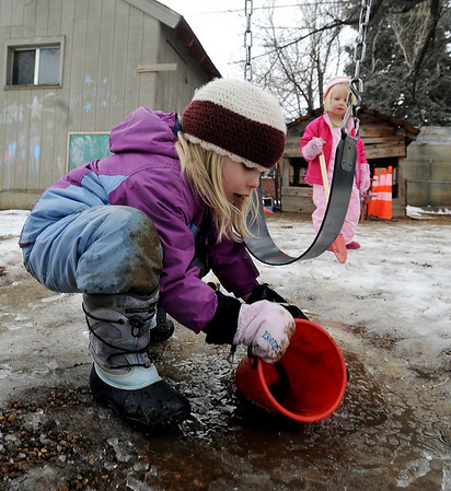 "Isabel Link, 5, adds water to the frozen ground at the Homestar  Child Development Preschool. For more photos of the kids, go to  <a href=""http://www.dailycamera.com"">http://www.dailycamera.com</a><br /> <br /> Cliff Grassmick / January 14, 2010"