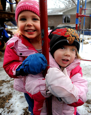 "Emerson Youngren, left, and Stella Delaney, both 3, play outside the Homestar Child Development Preschool in Boulder. For more photos of the kids, go to  <a href=""http://www.dailycamera.com"">http://www.dailycamera.com</a><br /> Cliff Grassmick / January 14, 2010"
