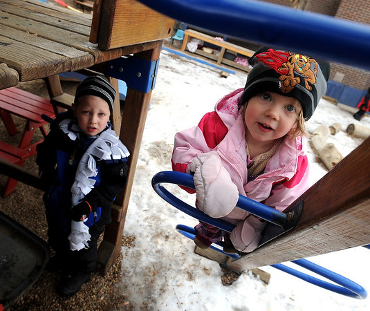 "Caleb Sheridan-Michaels, left and Stella Delaney, play outside at the Homestar Child Development Preschool in Boulder on Thursday. For more photos of the kids, go to  <a href=""http://www.dailycamera.com"">http://www.dailycamera.com</a><br /> Cliff Grassmick / January 14, 2010"
