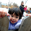 """Sophia Perria, 3, peeks over the fence of the Homestar  Child Development Preschool playground on Thursday. For more photos of the kids, go to  <a href=""""http://www.dailycamera.com"""">http://www.dailycamera.com</a><br /> <br /> Cliff Grassmick / January 14, 2010"""