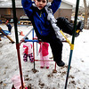 """Caleb Sheridan-Michaels, 5, plays on the climbing bars at the Homestar Child Development Preschool with the other kids on Thursday. For more photos of the kids, go to  <a href=""""http://www.dailycamera.com"""">http://www.dailycamera.com</a><br /> <br /> Cliff Grassmick / January 14, 2010"""