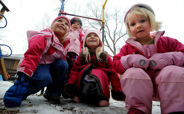 "Emerson Youngren, left, Stella Delaney, Gwen Stillman, and Neva Upton, all 3 years, play outside the Homestar Child Development Preschool in Boulder on Thursday. For more photos of the kids, go to  <a href=""http://www.dailycamera.com"">http://www.dailycamera.com</a><br /> Cliff Grassmick / January 14, 2010"