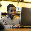 North Central Charter Essential School sophomore Jay Jupiter, 15, of Fitchburg works on a computer programming project on Tuesday as part of Hour of Code, a campaign hosted by Code.org, a non-profit organization that seeks to enhance awareness and growth of computer science in the nation's schools.<br /> SENTINEL & ENTERPRISE / BRETT CRAWFORD