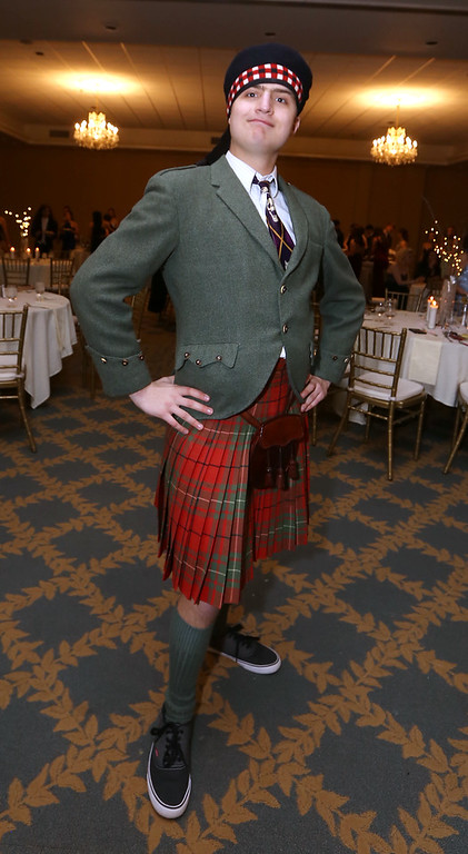 . Innovation Academy Charter School prom, at Westford Regency. Tristan Row of Groton came in what was something like his great-grandfather\'s kilt. (SUN/Julia Malakie)