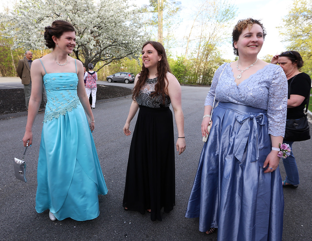 . Innovation Academy Charter School prom, at Westford Regency. From left, Becca McKiel of Lowell, Katie Therrien of Tyngsboro and Alyx Dunn of Chelmsford. (SUN/Julia Malakie)