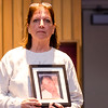 "Cheryl Juaire holds a photo of her son Corey Merrill, who she lost to addiction, during a showing of the short film ""If Only"" at North Middlesex Regional High School on Tuesday evening. ""If Only"" is a short film intended for teens, parents and adults to raise awareness about the dangers of prescription drug misuse and abuse and to start a conversation that encourages the safe use, storage and disposal of prescription drugs to keep them out of the hands of kids. SENTINEL & ENTERPRISE / Ashley Green"