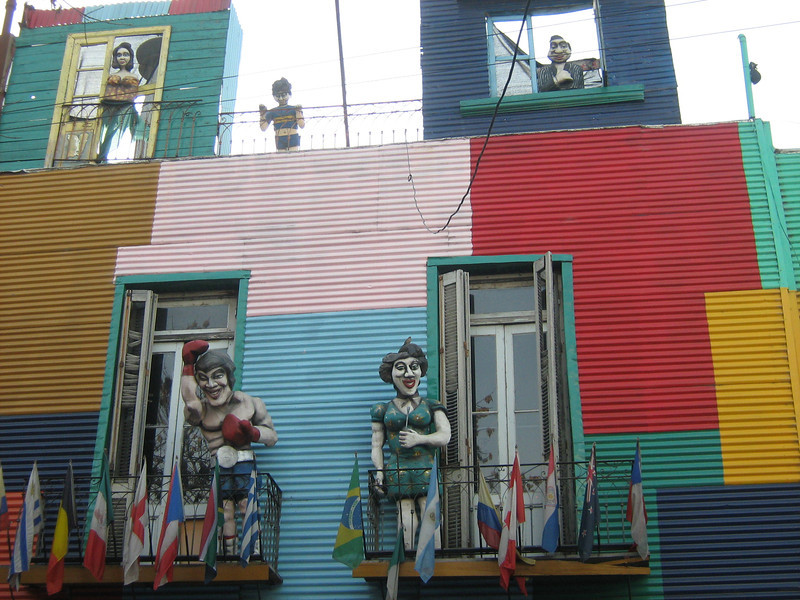 Figures on balconies about Boca ally, above restaurant in which group ate.
