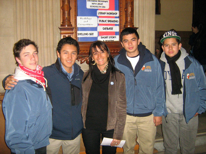 Cubs (Cooper, Misael, Jimmy, Jason) pose with Colegio del Salvador's Exchange Program Coordinator and Chair of English Department, Eugenia Sanguinetti, in foyer of school, Friday, July 8, 2011. Muchas gracias, Eugenia!