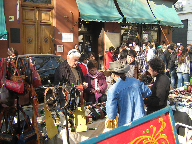 Sunday, July 10, 2011. Mr. Z and Ms. M examine the wares at a huge street fair in San Telmo district of BA.