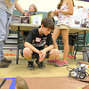 John R. Briggs Elementary School held a Mars rover derby, where technology students built rovers and local judges picked a winning rover on Friday morning at the school. Watching his Rover is fifth grader Jeremy Hansen, 11. SENTINEL & ENTERPRISE/JOHN LOVE