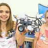 John R. Briggs Elementary School held a Mars rover derby, where technology students built rovers and local judges picked a winning rover on Friday morning at the school. Fifth graders laura Oliveira, 11, and Kaela Hillman, 11, show off their rover that they named Courage.  SENTINEL & ENTERPRISE/JOHN LOVE