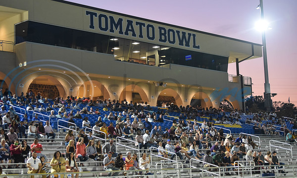 Families social distance at the Tomato Bowl while attending the Jacksonville High School graduation on Tuesday, June 2.