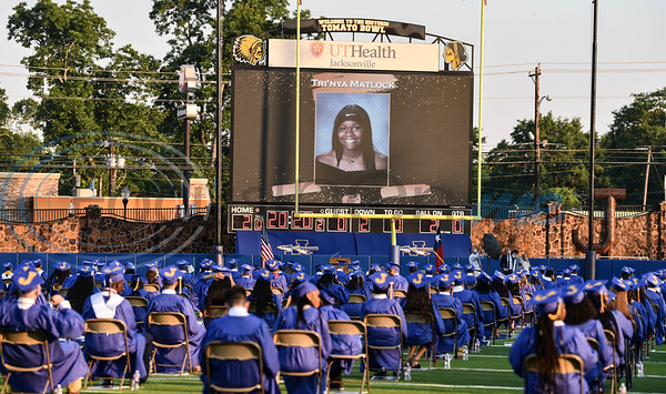 Jacksonville High School graduate photos appear on the jumbotron prior to graduation on Tuesday, June 2. 285 students received their diploma at and in-person ceremony at the historic Tomato Bowl.