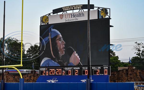 Jacksonville High School senior Katlin Gonzalez sings the National Anthem via jumbotron at the school's graduation ceremony on Tuesday, June 2.