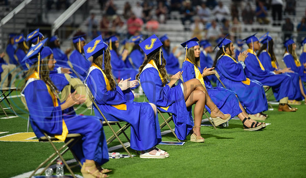 Jacksonville High School seniors applaud during their graduation ceremony at the historic Tomato Bowl on Tuesday, June 2.