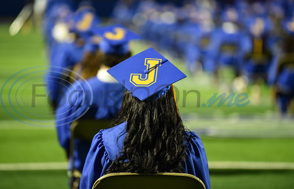 """A gold """"J"""" is displayed on the Jacksonville High School senior caps. The Fighting Indians held and in-person graduation ceremony at the Tomato Bowl on Tuesday, June 2."""