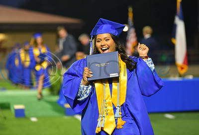 A Jacksonville High School graduate celebrates after receiving her diploma during a graduation ceremony at the historic Tomato Bowl on Tuesday, June 2.