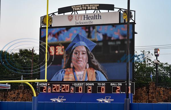 Jacksonville High School Valedictorian gives her speech via jumbotron at the school's graduation ceremony on Tuesday, June 2.