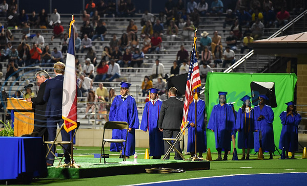Jacksonville High School seniors line up to receive their diplomas at their graduation ceremony on Tuesday, June 2. The celebration took place at the historic Tomato Bowl.