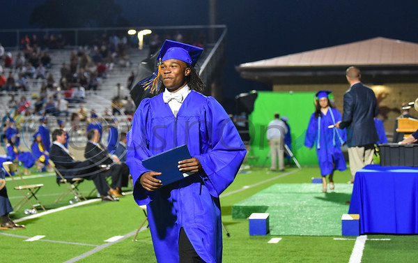 Standout student-athlete Chris Carpenter, who is headed to Colorado University in the fall to play football, smiles after receiving his diploma at the Jacksonville High School graduation on Tuesday, June 2.