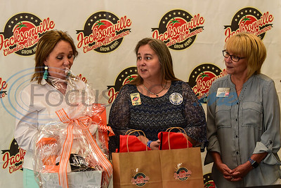 Whataburger Marketing Director Shelly Lipe (left) prepares to announce the winner of the Jacksonville What-A-Teacher of the Year with Jacksonville Chamber Education Chair Pam Anderson (middle) and Jacksonville Chamber President Peggy Renfro (right). The winner was announced on Thursday, May 7th during Teacher Appreciation Week via Facebook Live Stream.