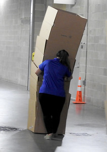 Miss Hescheles helps move the boxes