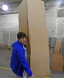 Spencer Farfante (.'20) moving supplies