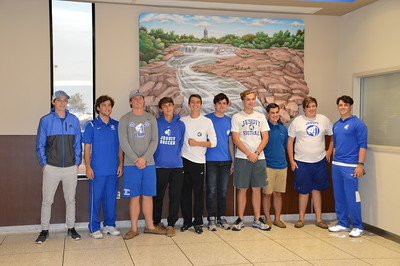 Finally made it to Sioux Falls after a layover in Denver - Our Jesuit Mission Crew...Shaughn Layton, Seth Cashen, Chris Jennings, Ben Ledwon, Jack Mahoney, Jordan Vivero, Ian Halme, Jake Rodriguez, Harrison Redd, and Preston Lawn by the Sioux Falls Painting at the Airport