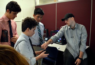Print Lab Tech explains the structures of the 3-D Model to the Team (L - Joey Santana, F - Frankie Machado, R- Viet Ho)