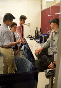 Print Lab Tech explains the structures of the 3-D Model to the Team (L - Viet Ho, C - Frankie Machado, R- Joey Santana