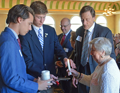 John Cullaro, Kyle Erickson, and Consul General of Peru - Jorge Geldres help survivor - Helen Borenstein light her candle in honor of 1 of the 6 million Jewish men, women and children who perished during the Nazi Era